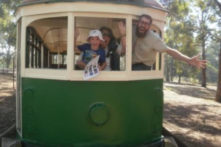 Marc with rangers Julia & Sam driving the tram at Wattle Park